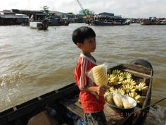 Mekong Delta Travel, Ho Chi Minh City, Vietnam. Floating #market in #Vietnam where you can fresh pineapple of the boats :-)