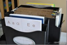 spinning desktop file organizer with side pockets - this mom is using it for homeschool printables, worksheets and other printouts organized by week of school year