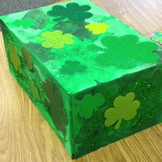 Leprechaun Trap-Kid painted and decorated box with shades of green tempra paint, glitter and shamrocks. Perfect for Leorechaun catching