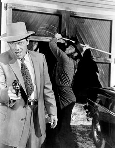VIOLENT SATURDAY - Amish farmer (Ernest Borgnine) attacks bank robber (Lee Marvin) from behind - Shot in Arizona - Based on novel by William L. Heath - Directed by Richard Fleisher - Century-Fox - Publicity Still.