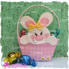 Cute painted wooden Easter Bunny in a basket.