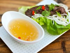 Nuoc Cham Recipe | That sweet, sour, and salty sauce had an irresistible mixture of flavors that were instantly attractive. The combination of that and the crackling crust of the spring roll let me know, in no uncertain terms, that I had a love for food deeper than I had previously known. #condiments #sides #recipes #flavorbombs #seriouseats #recipes