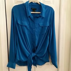 Blue blouse Blue button down blouse from INC in size 16W.  Tie front or tuck in pant or skirt. I also have one available in black. Polyester INC International Concepts Tops