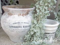 DIY French Flower Pots: Reverse print image, postion face down on pot/item to be decorated, apply modge podge, allow to dry completely (12 hours), spritz with water to remove paper - amazing!