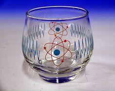 Atomic Lokade : Shake with ice 4oz lemonade, 1oz vodka, 3/4oz blue curacao, 1/2oz triple sec, simple syrup (or superfine sugar) to taste. [OO]----------------------------------- IGUANA : 1oz each vodka, triple sec, Midori melon. Fill with lemonade. -- [OO]