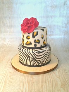 Animal Print Cake - Cheetah and zebra print girly birthday cake, with a large red gumpaste rose.