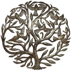 The intricate Tree of Life wall hanging will make a fashionable addition to your home decor. Crafted of recycled oil drums, this decorative accessory is representative of the spirituality of the Haitian culture