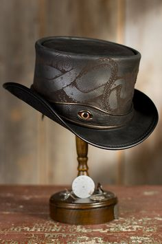 Don't be shy. Our wicked Steampunk Kraken Leather Top Hat is unafraid, with its lighted porthole and octopus eyeball. Free shipping   returns.