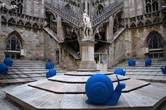 In collaboration with the Duomo and Opera d'Arte in Milan, international art collective Cracking Art Group created and placed 50 blue snail sculptures on the cathedral's roof to call attention to much-needed repairs and restoration. The snails, a motif commonly used by the group, are made from recycled plastic and allude to the gradual deterioration of the architecture. What an incredibly fun and creative endeavor!