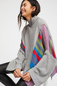 We The Free Susie Swit   Cozy up in this so soft long sleeve top featuring a swingy, oversized shape and contrast sweater and knit fabrications. * Striped design throughout * Mock neck * Unfinished edges for a lived-in look * Side vents