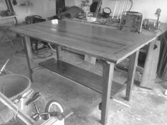 This is a beautiful reclaimed oak top table, with a cedar base. It is 42″ high x 82″ long and 42″ wide.