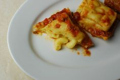 Creamy mac and cheese stuffed in a homemade ravioli served in a hearty tomato sauce.