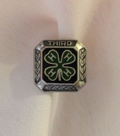 Very nice sterling silver 4-H clover leaf pin. Top of pin says THIRD. Very good condition. Clasp closure works great. Marked on back sterling