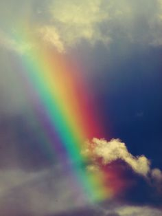 Truly, awesome...(bright blue sky with clouds, and colorful rainbow)