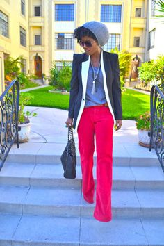 Beverly Hills Fashion stylist/designer Folaké Kuye - Bright red/hot pink trouser pants, simple tank, layered tassel necklaces, black+white blazer