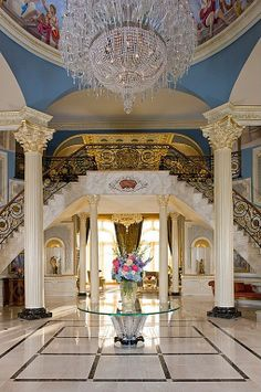 Marble - simple, Crown molding, Cathedral/Arched, Traditional, Columns, Built-in bookshelves/cabinets, Loft, Chandelier