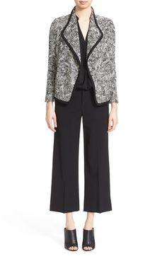 Black culottes, black tweed/boucle jacket, black top, black chunky mules