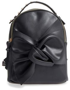 $14.97 OMG Imitation Pearl Handle Bow Mini Backpack. Lustrous imitation pearls stud the handle of a curvy, compact faux leather backpack embellished with a lavish twisted bow. #ShopStyle #nordstromrack #fashion #style #bags #backpacks