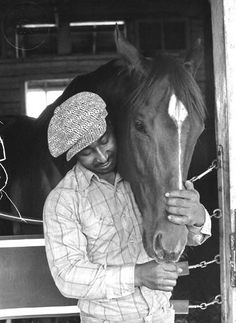 Secretariat with his groom Eddie Sweat.  No one was closer to Secretariat then he was.  What a special relationship!  Secretariat is my favorite athlete of all time!