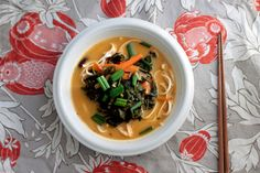 Healthy vegan rice noodle soup in creamy coconut kale broth - Peaceful Dumpling