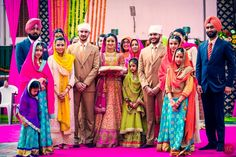 Weddings from Punjab have that blend of rustic with the modern, the blend of vivid colors with joyous emotions that are a bit of a treat to see.  Raman and Gurmans wedding is no different - right from the bride's lehenga to the maang tikka's and jhoomers on the guests, to the groom's