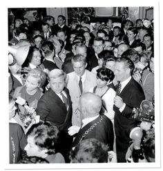 Steve McQueen with his first wife, Neile Adams, at an auction in the Ritz, 1964 | PHOTOGRAPH FROM AGIP/RUE DES ARCHIVES/THE GRANGER COLLECTION.
