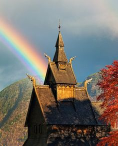 Sunlight pierces though a heavy sky to create a rainbow over Hopperstad Stave Church in Vik, Norway. This church was built around the year The Stave churches are constructions of high quality, richly decorated with carvings. Les Fjords, Rainbow Sky, Rainbow Bridge, Old Churches, Place Of Worship, Kirchen, Travel Photographer, Beautiful Places, Places To Visit
