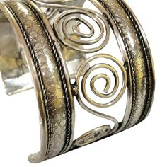 Brass Silver-plated Swirls Handmade Cuff Bracelet https://sitaracollections.com/collections/bracelets-cuffs-and-bangles/products/brass-silver-swirl-cuff