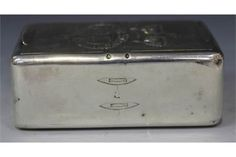A rare George III Irish silver double snuff box, of rectangular form with two hinge lids revealing compartments, the top engraved with a crowned crest, the garter inscribed 'Royal South Downs IX', one end engraved with wreath framing a St Patrick's Cross and clover leaf, the other with a spinning wheel, the sides with four shuttles, Dublin 1810 by James England and William Law, length approx 8.8cm.