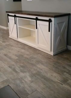New (never used) - Gorgeous  custom built TV console/entertainment center  with sliding barn doors.  These are built to order, so you choose the size and the paint color and/or stain color that works the best for you. $595.00