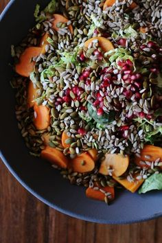 Shaved Brussels Sprout Salad // Ingredients: 1 pound of brussels sprouts; 3-4 Fuyu persimmons; 6 ounces of pomegranate seeds; 1/2 cup of pumpkin seeds, shelled and toasted; 1/3 cup of sunflower seeds, shelled