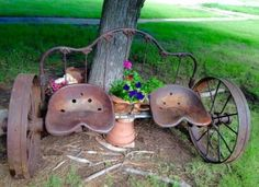 Vintage iron headboard, iron wagon wheels, and tractor seats repurposed to a garden bench. Horse shoes serve as drink holders. Backyard Seating, Garden Seating, Backyard Landscaping, Florida Landscaping, Landscaping Ideas, Diy Garden Decor, Garden Art, Garden Design, Outdoor Projects