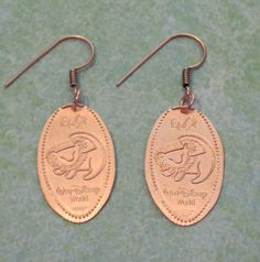 Disney World Epcot Simba Lion King pressed penny pure copper earrings. $9.00, via Etsy.