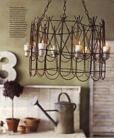 This garden style chandelier would look lovely in a rustic style kitchen and would be so easy to make yourself for a small amount of money. You don't have to spend hundreds or thousands of dollars to have a dramatic lighting fixture. #springintothedream