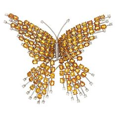 Gold butterfly brooch with diamonds and sapphires…