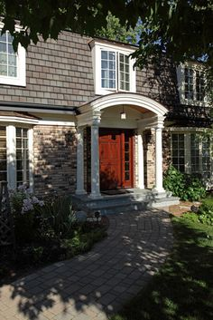 I love the updated mansard roof and arched entry.    Exterior - traditional - exterior - minneapolis - Knight Construction Design | Chanhassen, Minnesota
