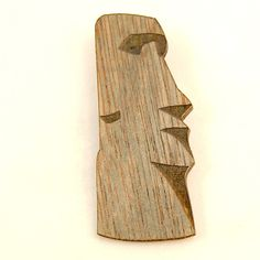 Wood Moai Tiki Brooch:Some your Easter Island love with this Moai! This greyish wood Moai brooch is made of sealed wood and is mounted to a silver pin back. The wooden pin has a carved wood Easter Island Moai head along with wood grain details. Measures 2 1/2 inches long by 1 inches wide. Made in USA. $14.00 #matchaccessories #tiki #brooch #carvedwood #polynesian #kitsch #moai