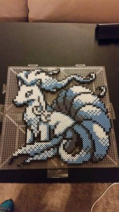 From Pokemon Sun and Moon here is the majestic Ninetails. Made out of over perler beads. Perfect for any fan of pokemon! Or anyone that is as excited for the new game as I am :D Its about 12 inches by 12 inches in size. Pearler Bead Patterns, Perler Patterns, Pearler Beads, Pokemon Cross Stitch, Modele Pixel Art, Pokemon Perler Beads, Hama Beads Design, Fusion Beads, Iron Beads