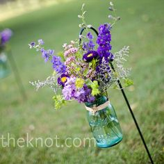 outdoor ceremony aisle idea, using clear mason jars and blue flowers...it'll tie in our reception decor perfectly!