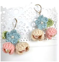 Delicate pink,blue and beige flower earrings. The flowers are crochet in thin cotton(I use my own patterns) with light green silk leaves. I added