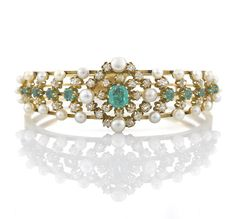An antique emerald, cultured pearl and diamond bangle bracelet, French, circa 1900