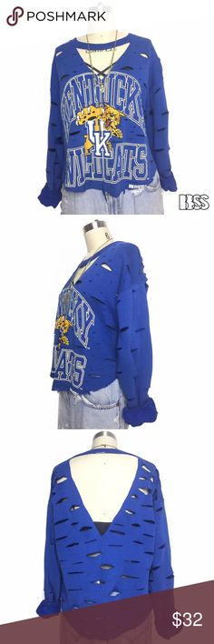VINTAGE KENTUCKY WILDCATS DISTRESSED SWEAT SHIRT!! VINTAGE REWORKED KENTUCKY WILDCATS DISTRESSED SWEAT SHIRT WITH COLLAR DETAIL!! Fabric is very cozy and extremely worn in! Graphic has begun to crack and looks perfectly aged! Top has been shortened, scalloped at the bottom, heavy distressing all over with double DEEP V in front and back! Vintage Tops Sweatshirts & Hoodies