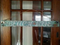 """Hand crafted distressed """"Beach Life"""" sign. I included pieces from Fairport Harbor beach."""