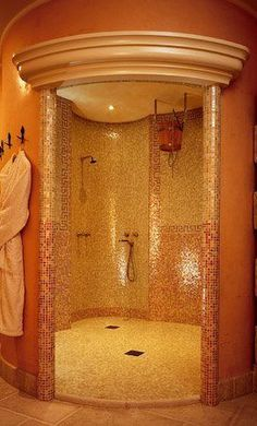 walk in shower. a little too Egyptian for me. But i like the concept of open door shower with spacious area.