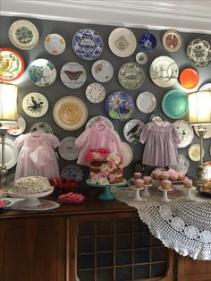 Tea party, baby shower, girly girl, girl baby shower, flowers, daisy, hankies, shabby chic party, shabby chic shower, tea set, tea cups, mix and match, eclectic, country chic, baby shower decor, baby dresses, hanging dresses at a shower, baby clothes decor  IG: ihavethecoolestgoatever