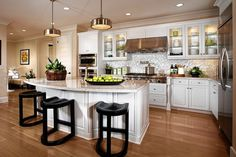 WSJ Mansion Kitchen Island With Curved Cabinets