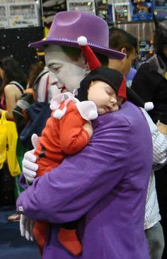 Harley Quinn Baby and Daddy Joker Cosplay.  My husband is so doing that with our first daughter