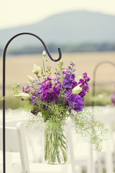 Love the shepherd hook, jar, and flowers for decorating the wedding aisle.
