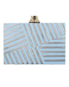 Graphic stripes in chrome and aqua resin alternate to create this Kelly Wearstler keeper. The sculptural flip-flop feet on top add a little something fun for a pool, lake, or ocean wedding.Fractured Clutch, $795, KellyWearstler.com.