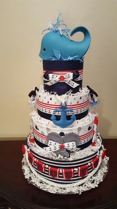 Nautical diaper cake! Fully loaded diaper cake centerpiece gift.  check out my Facebook page Simply Showers for more pics and orders.